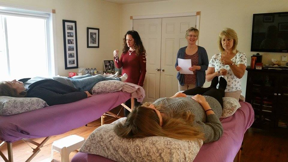 Reiki Master Susan Rouse teaching Reiki students.